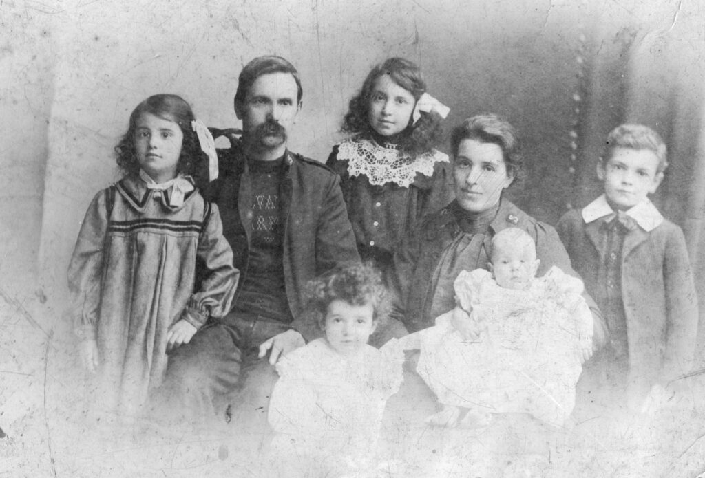 The Avery Family. A black and white photograph from the late nineteenth century, showing a father and mother with their four children.